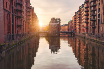 Historical famous warehouse district at sunset golden ray light located in Hamburg city old port, Germany, Europe