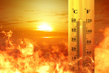 Obraz Thermometer with high temperature on the city with glowing sun background - fototapety do salonu