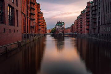 Hamburg, Warehouse District Speicherstadt. Germany, Europe. View of Wandrahmsfleet on evening light, famous sightsee located in the port of Hamburg