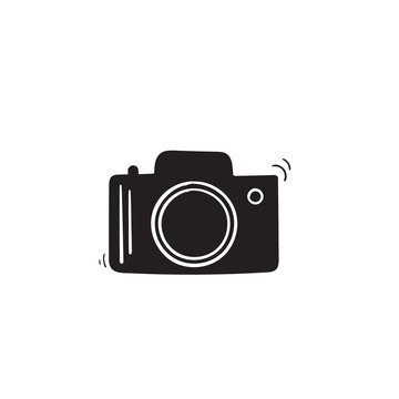 Photo camera vector icon with hand drawn doodle style isolated on white