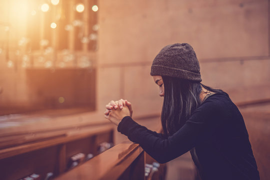 Close up prayer's hand pray in church, Young woman pray to God, with blank copy space
