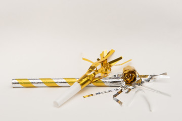 Isolated yellow party blowers on white background