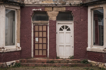 Entrance doors to a run down house in Blackpool, England, UK