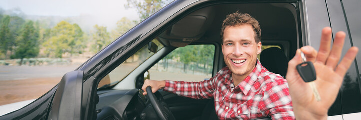 New car young man driver happy holding keys driving rental on road trip vacation travel holiday...