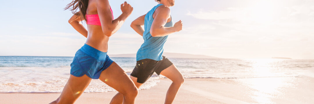 Run fit people running on beach with healthy toned legs body, Hamstring muscles, knee joint health active lifestyle panoramic banner background.
