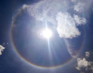 The sun halo natural phenomenon . Troposphere layer. defocused image