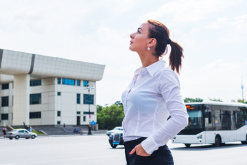 young successful business woman looking at the city