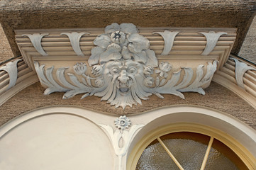 elaborate stucco ornament above an house entrance, old town munich schwabing, historic building