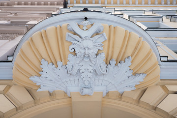 elaborate baroque ornament above a house entrance, old town munich schwabing, historic building