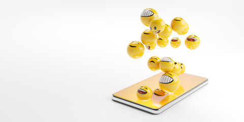 Smartphone on the white table with yellow emoji characters flying from the screen. Copy space.