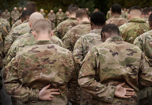 US soldiers. US army. US soldiers pray. Military of USA. Memorial day.
