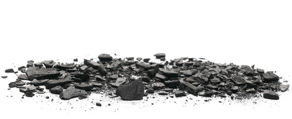 Charcoal chunks pile isolated on white background Wall mural