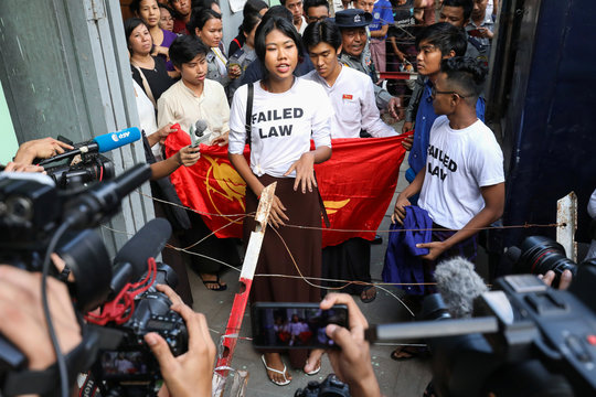Su Yadanar Myint, a member of the Peacock Generation, a satirical poetry troupe, speaks to media outside of Botataung court in Yangon,
