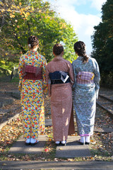Kyoto,Japan-November 14, 2019: Ladies wearing Kimono on the rail of Incline at Keage Incline in Kyoto