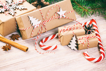 Wall Mural - Christmas time concept, Christmas gifts and traditional New Year sweets candy cane on wooden bachground. Top view copy space. Toned