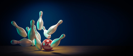Fototapete - Bowling ball hits the pins by doing a strike.