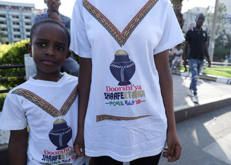 A mother and son wear t-shirts with a picture of ÔÕShafetaÓ the Sidama referendum symbol in Hawassa