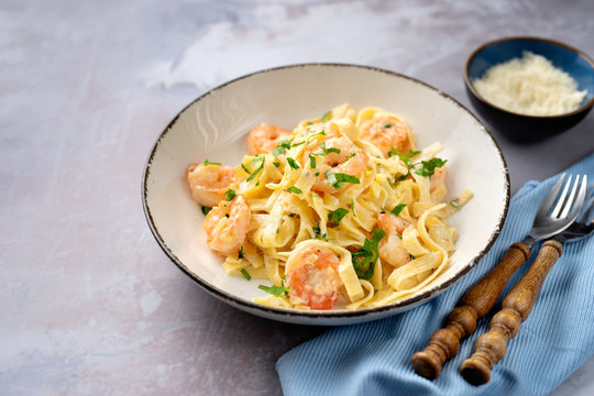 Tasty creamy shrimp fettuccine alfredo with parmesan