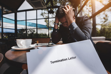Termination of Employment and layoff concept, Stressed businessman feeling down after received Termination