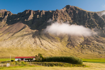 House at mountain's foot, Iceland