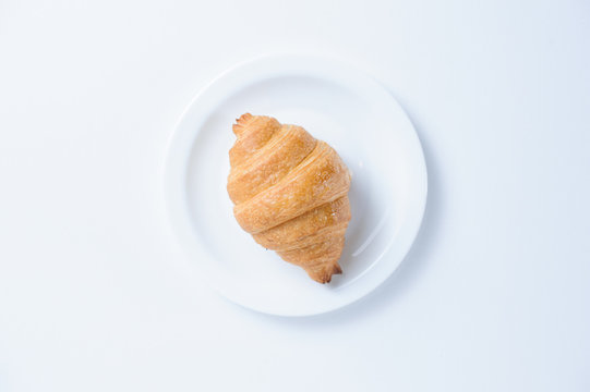 croissant on a plate isolated on white