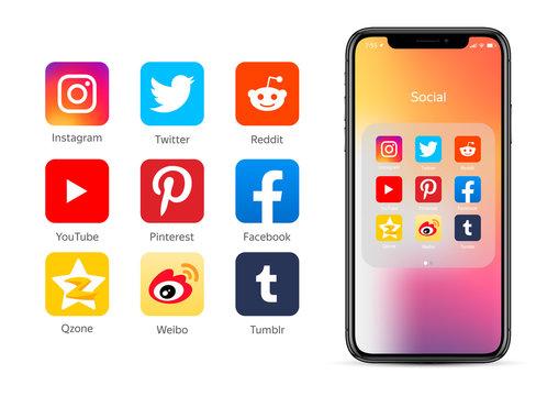 Smartphone with social network icons: Facebook, YouTube, Instagram, Qzone, Weibo, Twitter, Reddit, Pinterest, Tumblr
