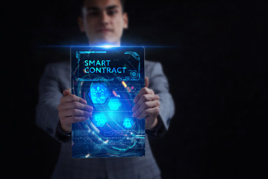 Business, Technology, Internet and network concept. Young businessman working on a virtual screen of the future and sees the inscription: Smart contract