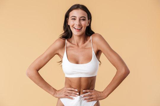 Cheerful smiling young woman in swimwear