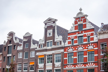 Foto op Plexiglas Amsterdam Close detail of traditional Dutch Late medieval houses in Amsterdam with ornaments decorations and windows