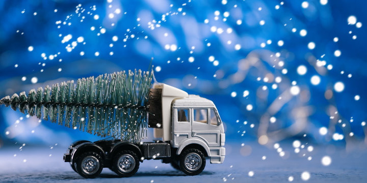 Toy truck carries Christmas tree