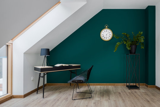 Home office with emerald wall