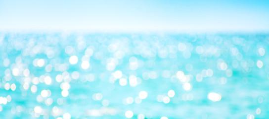 Defocused sea water surface glittering on the sun.