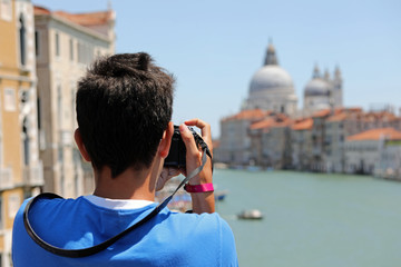 boy takes pictures at Basilica called Madonna della Salute in Ve