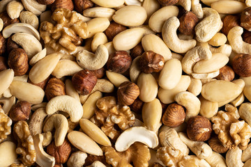 frame filling different nuts as background texture (walnut, hazelnut, almond,..)