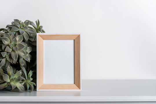 mock up made from photo frame in scandinavian minimalist interior with succulents