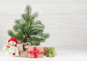 Christmas card with fir tree and gift boxes