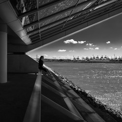 Girl in modern architecture in front of river Elbe in Hamburg