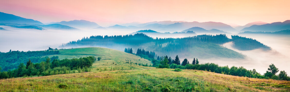 Foggy morning panorama of mountains valley. Splendid summer sunrise in Carpathian mountains, Rika village location, Transcarpathian, Ukraine, Europe. Beauty of nature concept background.