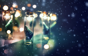 Fototapete - Close-up, Elegant Christmas tree in glass jar with snowflakes background. copy space.