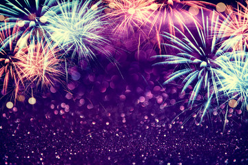 Fototapete - Purple colorful fireworks and bokeh in New Year eve and copy space. Abstract background holiday.