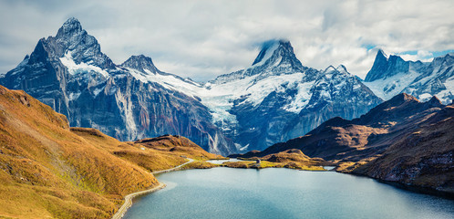 Tuinposter Bergen Spectacular morning view of Bachalp lake / Bachalpsee, Switzerland. Wonderful autumn scene of Swiss alps, Grindelwald, Bernese Oberland, Europe. Beauty of nature concept background.