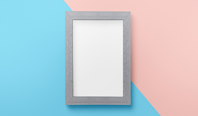 """Elevated view gray picture frame & blank white paper for copy space on blue & pink color two toned background,highly detailed resolution for backdrop decorated idea creative concept """" 3d illustration"""""""