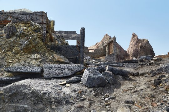 Abandoned concrete ruins deserted mining settlement