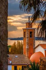 Beautiful sunset over Passignano historic center, Isola Maggiore (Greater Island) in Lake Trasimeno