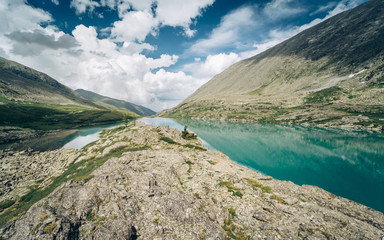 Wall Mural - Wild russian nature. Beautiful landscape with emerald lake in the mountains. Lake with clear turquoise water. Traveling in the Altai Republic. Active tourism in Russia. Siberian reserve.