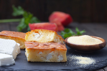 Homemade, freshly baked cornbread with cheese on dark background. Proja - bread  made of corn flour. Healthy food.