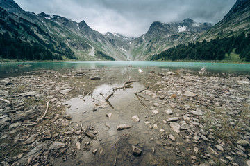 Wall Mural - Wild russian nature. Beautiful landscape with emerald lake in the mountains. Multa Lake with clear turquoise water. Traveling in the Altai Republic. Katun Nature Reserve.