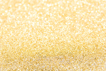 Defocused gold glitter background. Gold abstract bokeh background. Christmas abstract background.