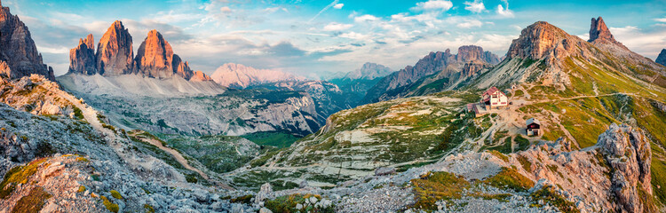 Impressive summer morning in Tre Cime Di Lavaredo National park. Panoramic summer view of rifugio Locatelli in Dolomiti Alps, South Tyrol, Italy, Europe. Beauty of nature concept background. Fotomurales