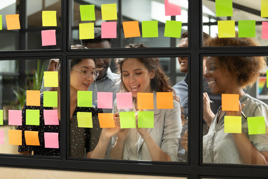 Diverse teammates satisfied with working process at office.